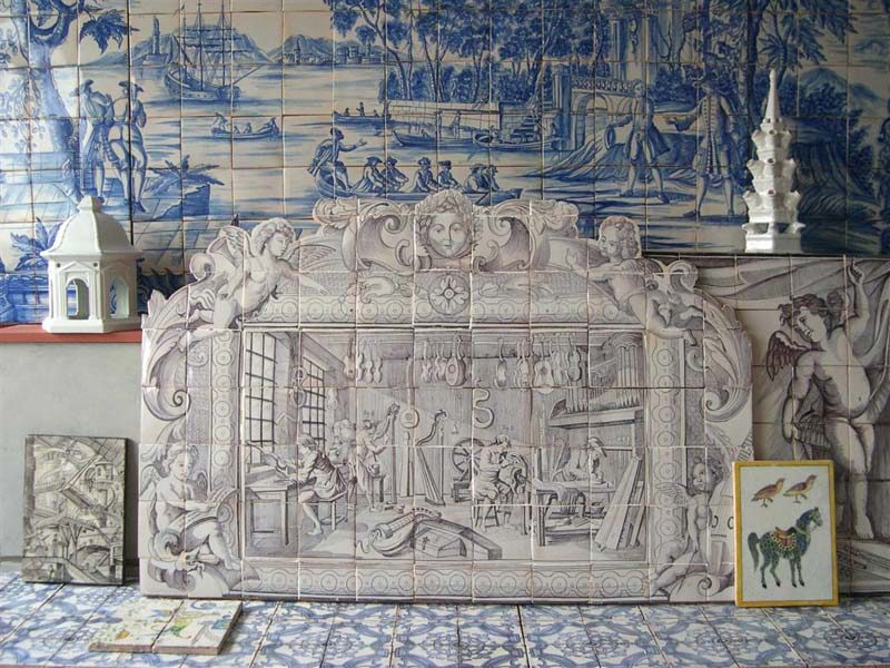 some tiles and murals exhibited in the showroom of the Paris-based Almaviva tile studio